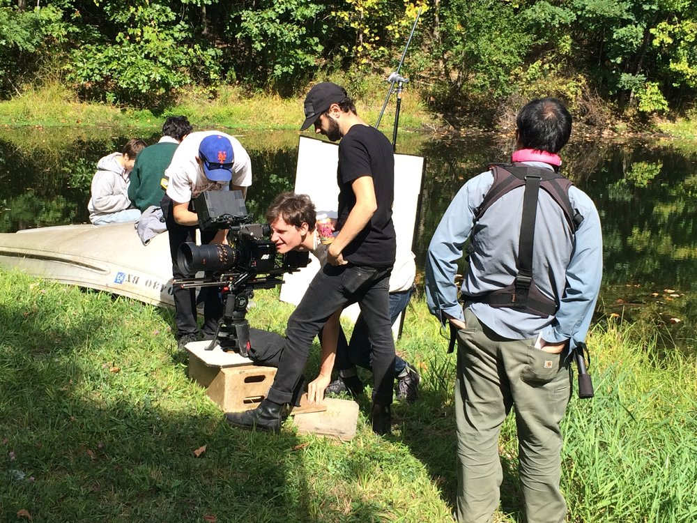 """Director Ryan Schnackenberg reviewing a shot on the set of """"On Earth"""""""