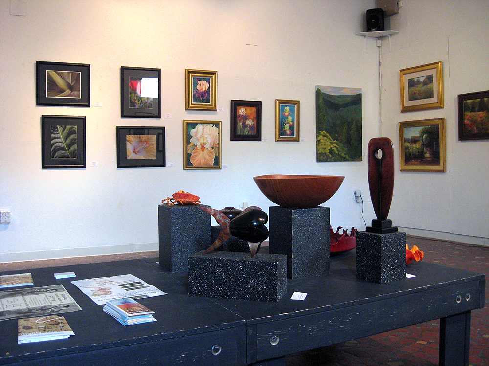 Gallery view of paintings and sculptures in Flora & Fauna