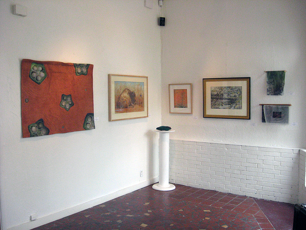 Gallery view of works by Elia Woods and Debby Kaspari.