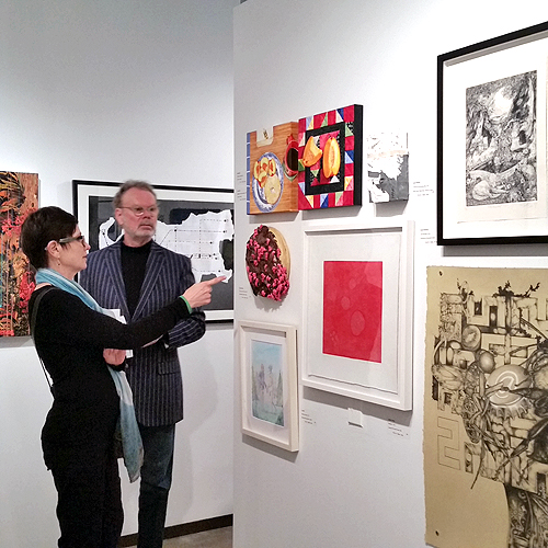 Visitors discussing work at the Dallas Art Fair, 2015