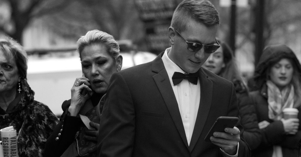The man with the tuxedo, the phone, and the sunglasses.                  (56 x 106 cm - Washington - Jan 20, 2017  )