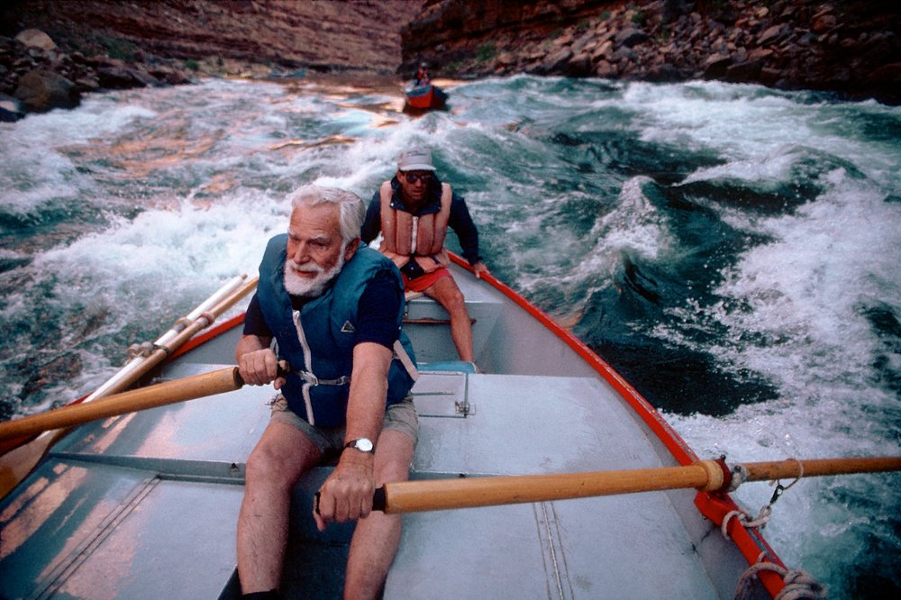 Martin Litton rowing through the Grand Canyon of the Colorado.  By Jim Richardson