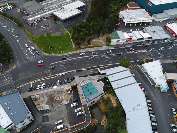 Aerial view showing renewal and restoration of Rewarewa Culvert, and the new pocket park and stream boardwalk in New Lynn.