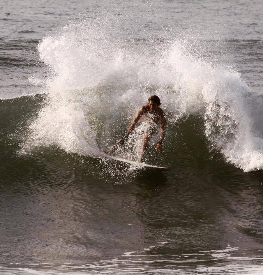 Diego shreds a wave, with respect for, not fear of, the sharks with whom he shares the ocean water.
