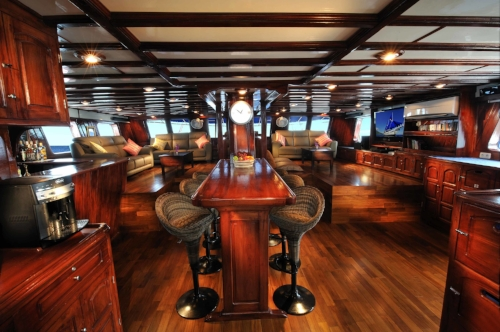 The Indo Siren's saloon is a beautifully furnished common area where you can relax after a long day of diving the best spots in the world.