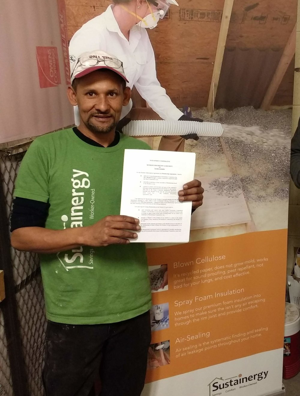 Yovany with his signed worker-owner contract.