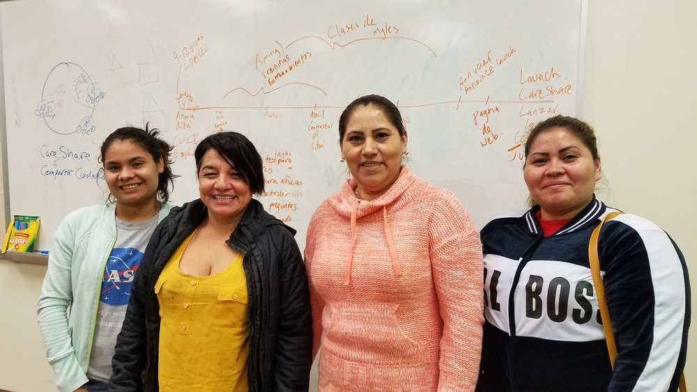 Pictured (r-l): Some of the CareShare organizing committee – Heidy, Maria, Alexis & Vilma (current CareShare provider) –working through launch timeline (on whiteboard behind).