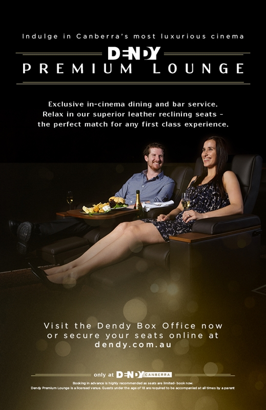 Movie cinema marketing material showing man and woman on date watching a movie in premium lounge with fine food and wine