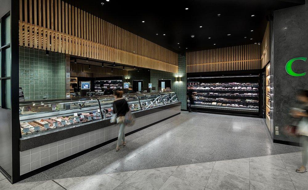 High end butcher shop fit-out with subway tiles and timber cladding offering quality meats