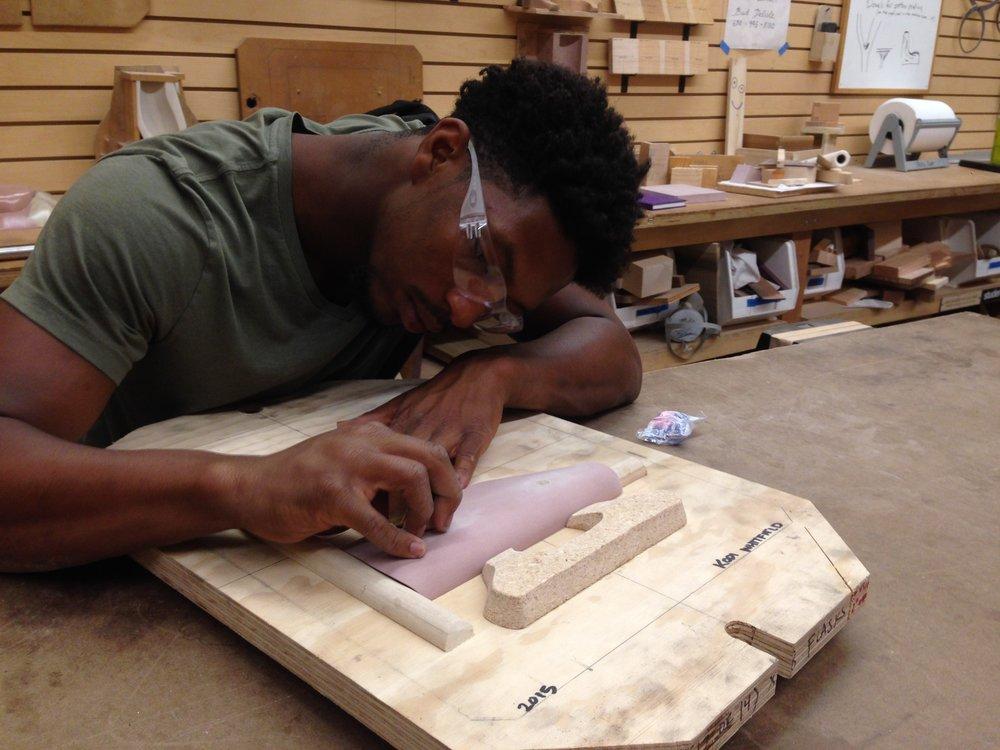Sanding the pattern board.