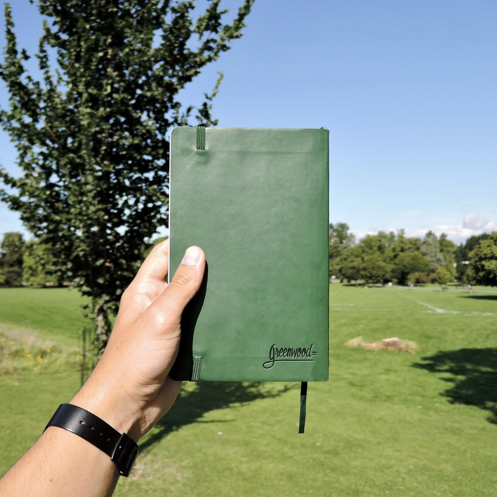A Greenwood Classic Notebook, sun shining.