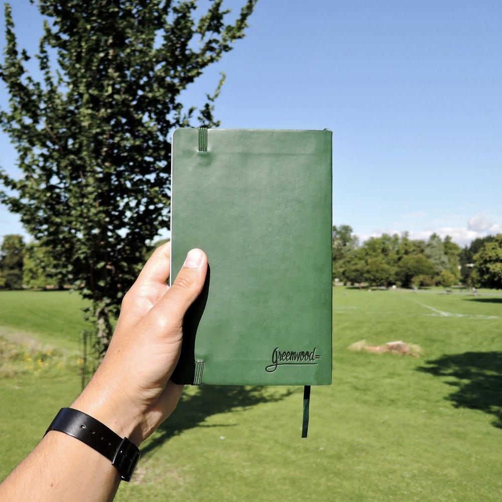 A Greenwood Classic Notebook, sun shining.
