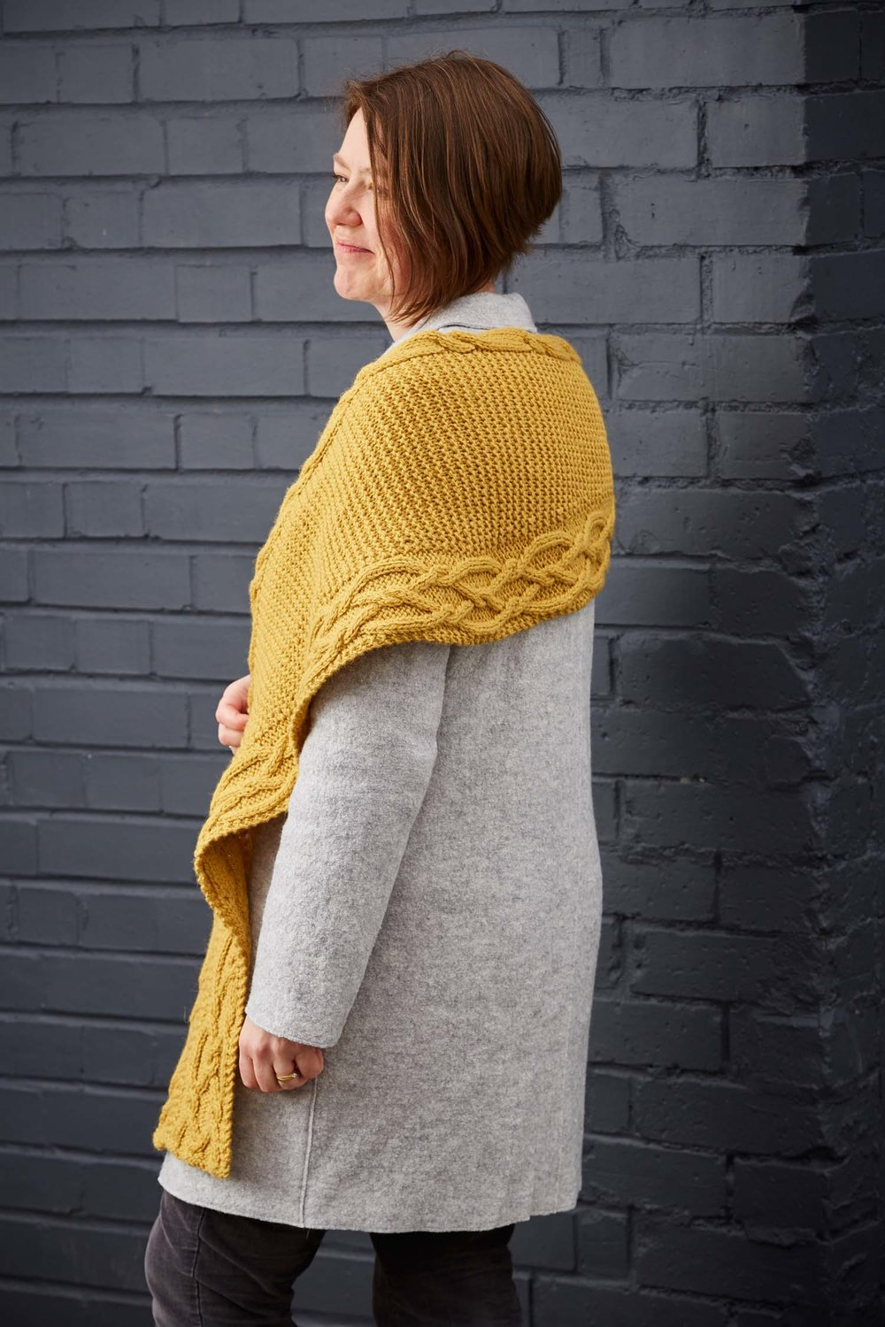 The two cable panels are separated by a garter stitch centre which is shaped to keep your neck cosy! Image © Jesse Wild.