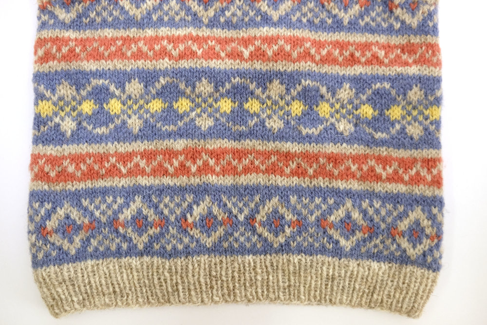 A reminder of the original colourway for the  Oorik Tank Top by Mary Jane Mucklestone . J&S Shetland Supreme in 2006 for the background and Jumper Weight shades FC15, 9144 and 66 for the patterning.