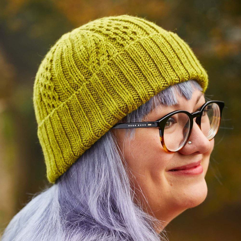 Rachel Coopey's Areto hat is one of the designs in Something New to Learn About Cables, and is the perfect design for newer cablers to practise their skills. Image © Jesse Wild.