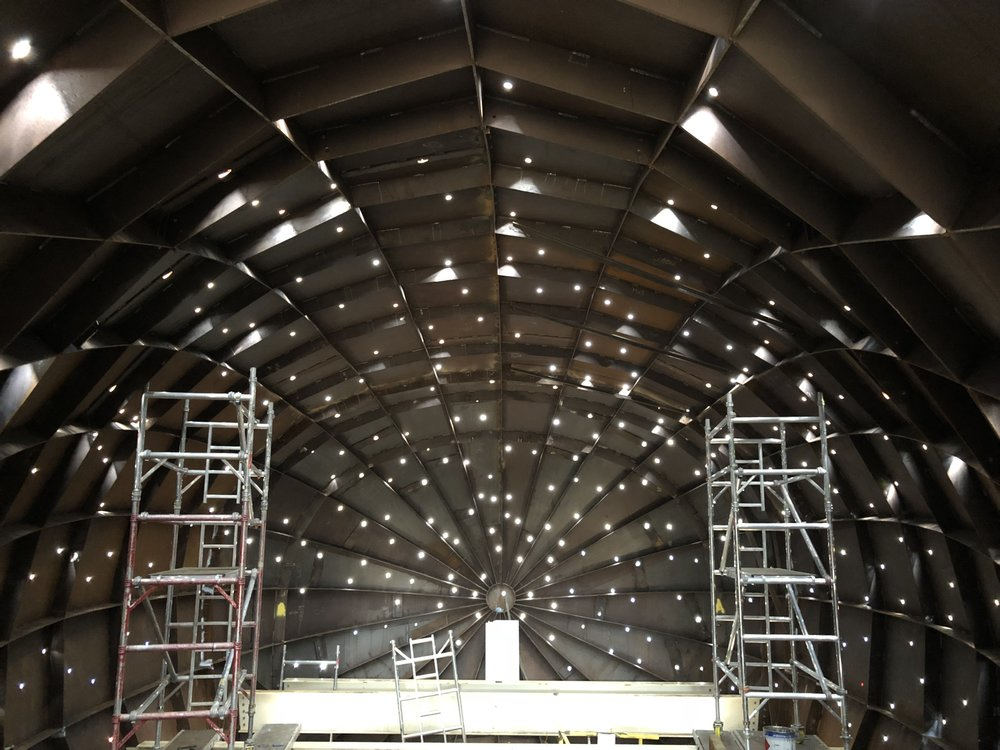 The raw interior during the fibre-optic installation phase.