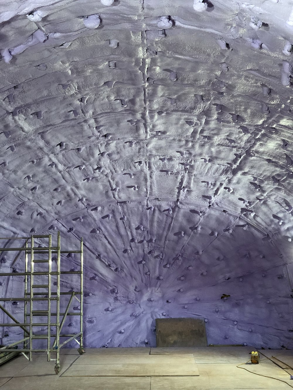 The first of 2 spray-foam coatings applied to the interior of the steel shell.