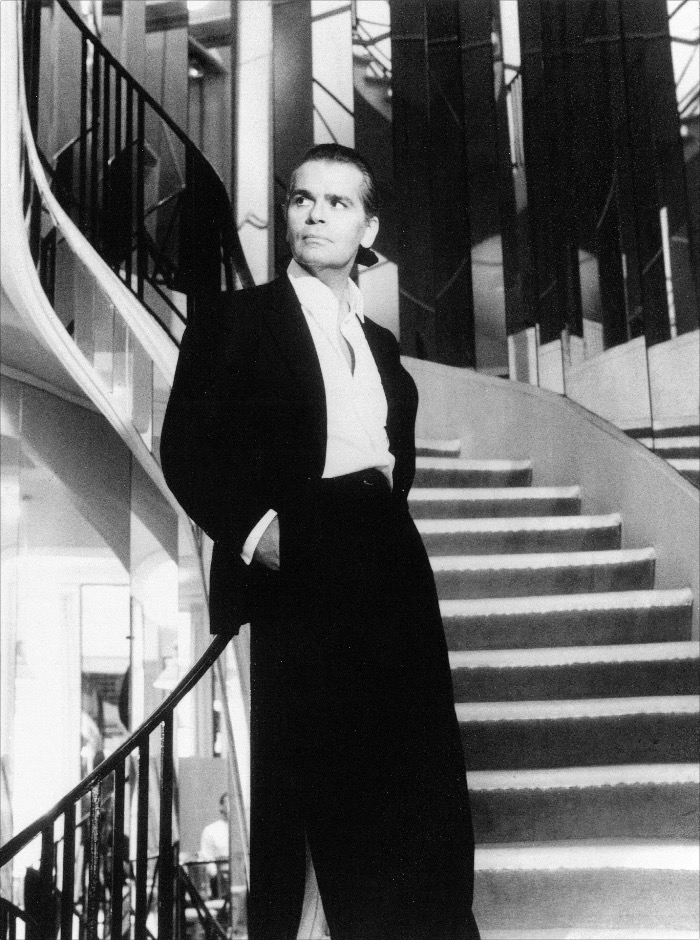 'Karl Lagerfeld on the stairs of Chanel, 1983' © The Helmut Newton Estate / Maconochie Photography