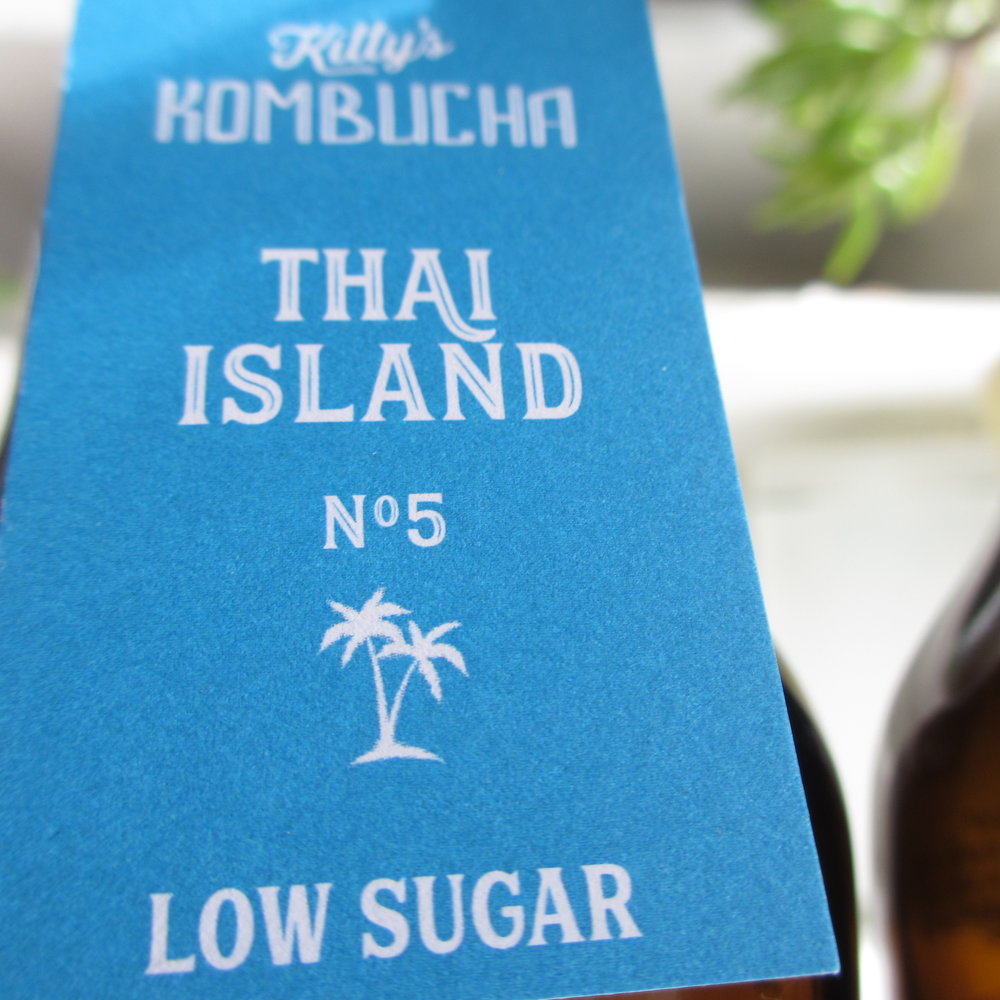 Thai Island  NO.5  Low in sugar... and wonderfully aromatic.  Incredible floral Thai herbal notes, strongly evocative of effervescent happy island-living. An original Kitty's Kombucha recipe from Thailand.  Hand crafted with Thai herbs, organic green sencha tea and cane sugar,  Thai Island  is a traditionally brewed kombucha in oak barrels, infused with a tisane (herbal tea) of lemongrass, ginger, kafir lime leaf, galangal and turmeric root.  And with less than 2.5g of sugar per 100ml, it's  low sugar  & just hits the spot!  Enjoy cold, perfectly as it is...  Alternatively, create a sprightly mixer on vodka or gin & ice, or whichever way you wish.