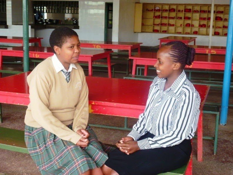 Esther Wagaki sharing a word of advice to Valentine Ngigi, an EFAC Scholar at Vanessa Grant Girls School.