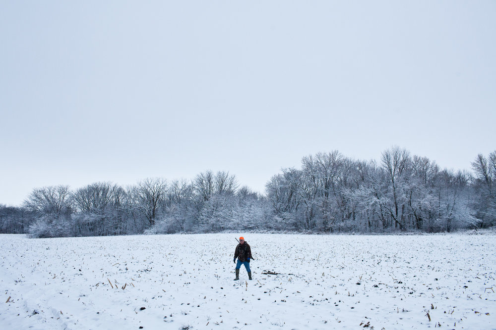 Mike Johnson stands in a corn field while deer hunting on Sunday, December 4, 2011 in Webster City, IA.