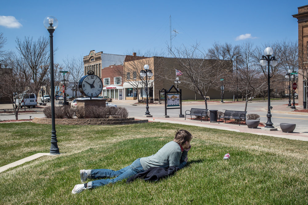 Cody Sleiter, age 17, lays in the grass after being suspended from school on Wednesday, April 24, 2013 in Webster City, IA.