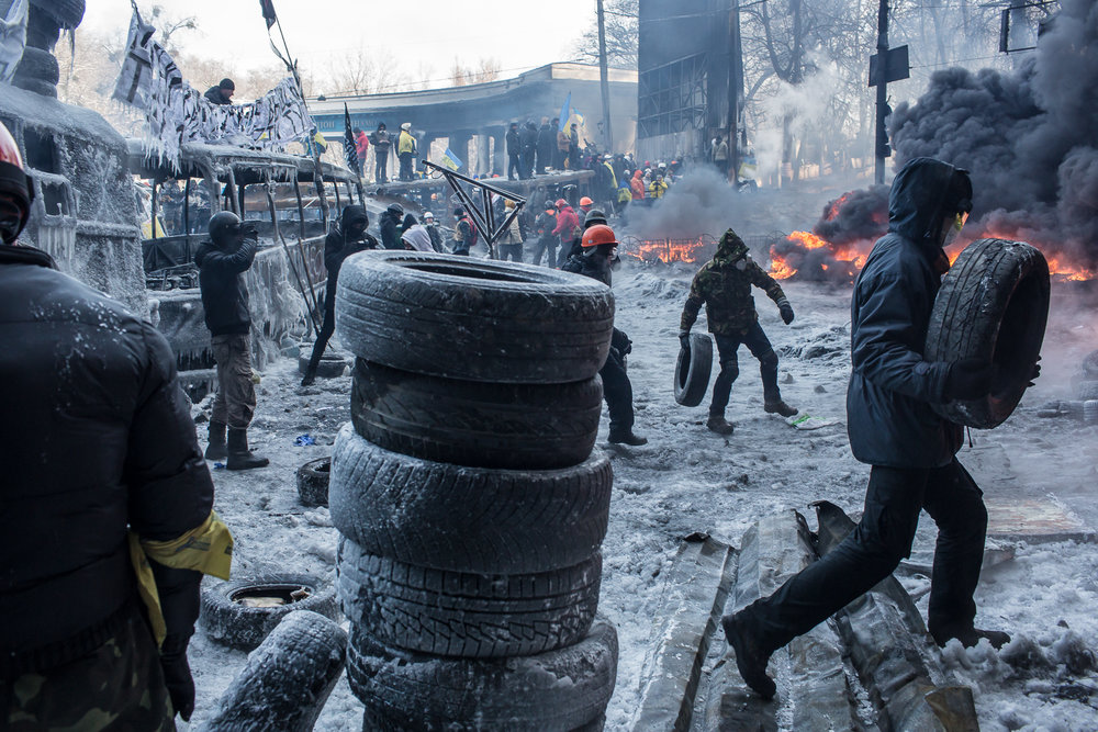 Anti-government protesters burn tires during clashes with police on Hrushevskoho Street near Dynamo stadium on January 25, 2014 in Kiev, Ukraine. After two months of primarily peaceful anti-government protests in the city center, new laws meant to end the protest movement have sparked violent clashes in recent days.