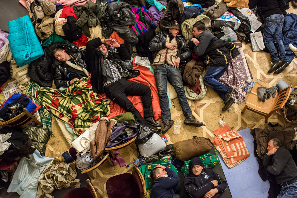 Anti-government protesters sleep on the floor of the occupied Kiev City Hall on December 7, 2013 in Kiev, Ukraine. Thousands of people have been protesting against the government since a decision by Ukrainian president Viktor Yanukovych to suspend a trade and partnership agreement with the European Union in favor of incentives from Russia.