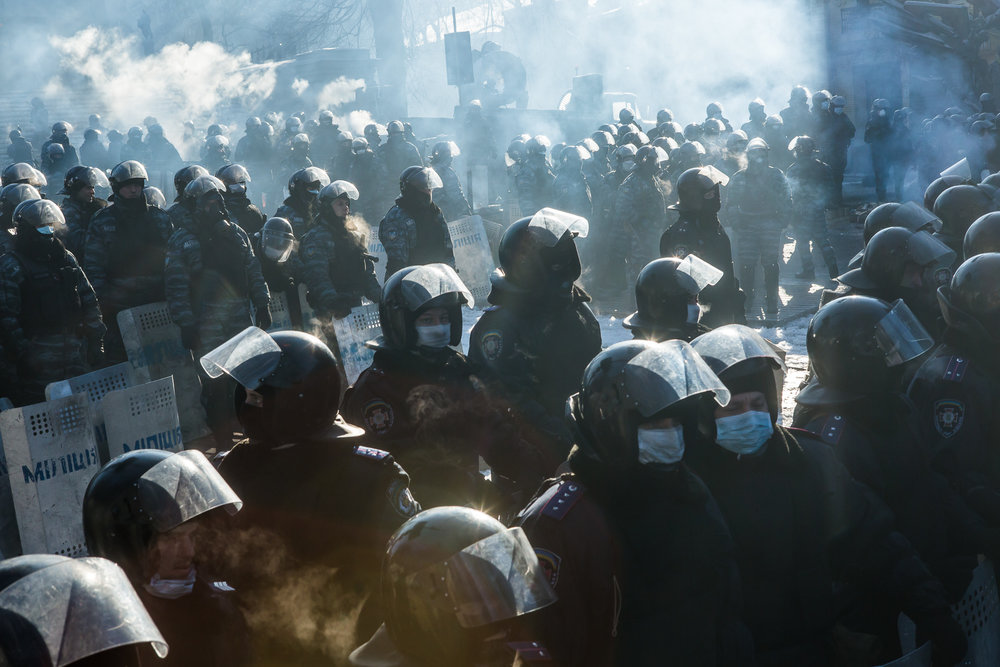 Police officers block the street near the Cabinet of Ministers building on January 24, 2014 in Kiev, Ukraine. After two months of primarily peaceful anti-government protests in the city center, new laws meant to end the protest movement have sparked violent clashes in recent days.
