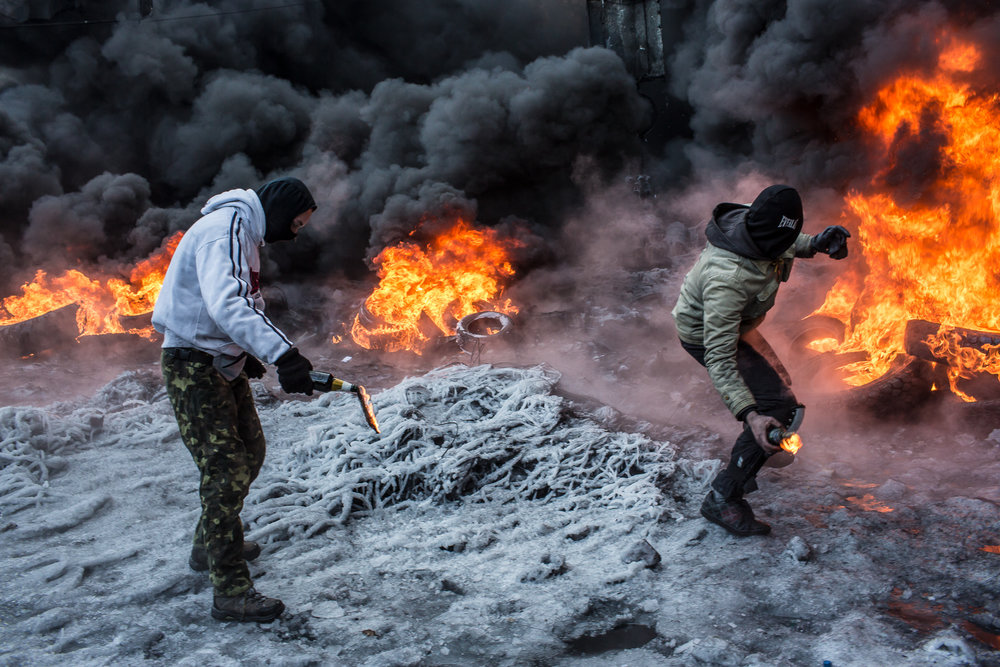 Anti-government protesters throw Molotov cocktails at police during clashes on Hrushevskoho Street near Dynamo stadium on January 25, 2014 in Kyiv, Ukraine. After two months of primarily peaceful anti-government protests in the city center, new laws meant to end the protest movement have sparked violent clashes in recent days.