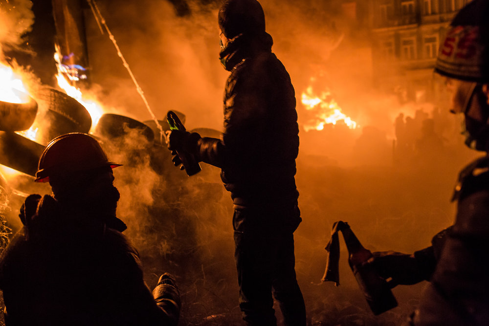Anti-government protesters prepare to throw Molotov cocktails during clashes with police on Hrushevskoho Street near Dynamo stadium on January 25, 2014 in Kiev, Ukraine. After two months of primarily peaceful anti-government protests in the city center, new laws meant to end the protest movement have sparked violent clashes in recent days.