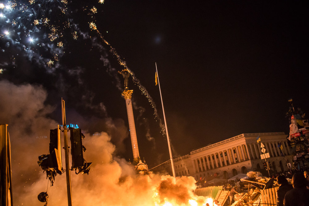 Fireworks fly over Independence Square, known as Maidan, during clashes in the early hours of on February 19, 2014 in Kiev, Ukraine. After several weeks of calm, violence has again flared between police and anti-government protesters, who are calling for the ouster of President Viktor Yanukovych over corruption and an abandoned trade agreement with the European Union.