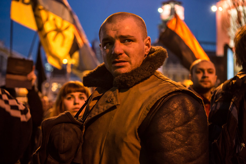 A man cries after seeing the body of Ustim Holodnyuk, 19, who was killed in fighting between anti-government protesters and police, carried in procession through Independence Square on February 21, 2014 in Kiev, Ukraine. After a week that saw new levels of violence, with dozens killed, opposition and government representatives reached an agreement intended to resolve the crisis. (Photo by Brendan Hoffman/Getty Images)