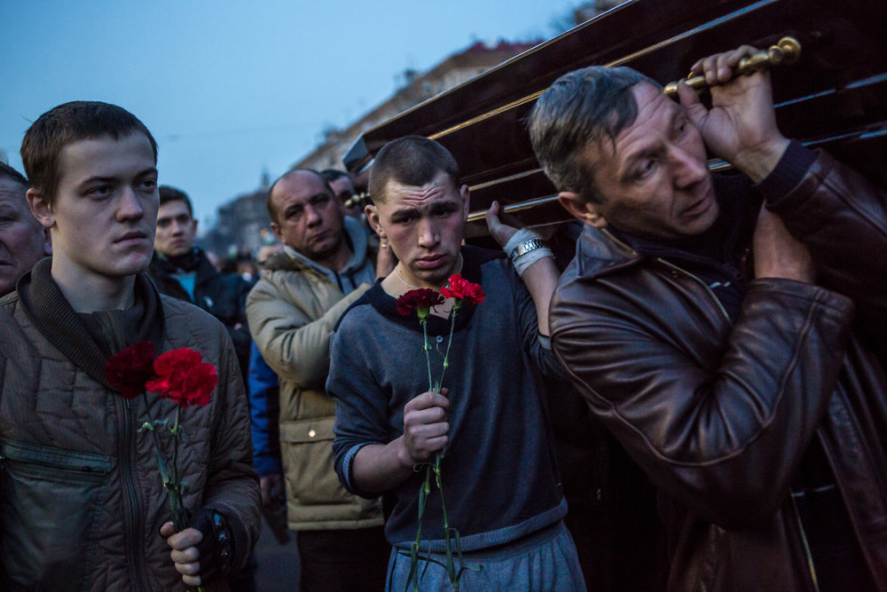 Men carry a casket containing the body of an anti-government protester killed in clashes with police from Independence Square on February 21, 2014 in Kiev, Ukraine. After a week that saw new levels of violence, with dozens killed, opposition and government representatives reached an agreement intended to resolve the crisis.