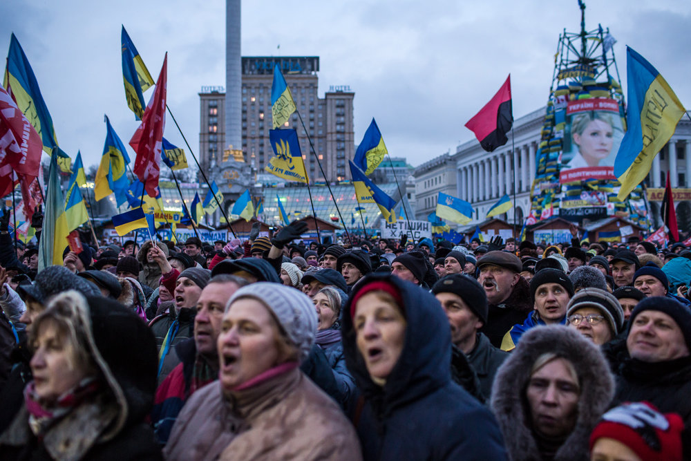 Anti-government protesters rally on Independence Square on December 7, 2013 in Kiev, Ukraine. Thousands of people have been protesting against the government since a decision by Ukrainian president Viktor Yanukovych to suspend a trade and partnership agreement with the European Union in favor of incentives from Russia. (Photo by Brendan Hoffman/Getty Images)