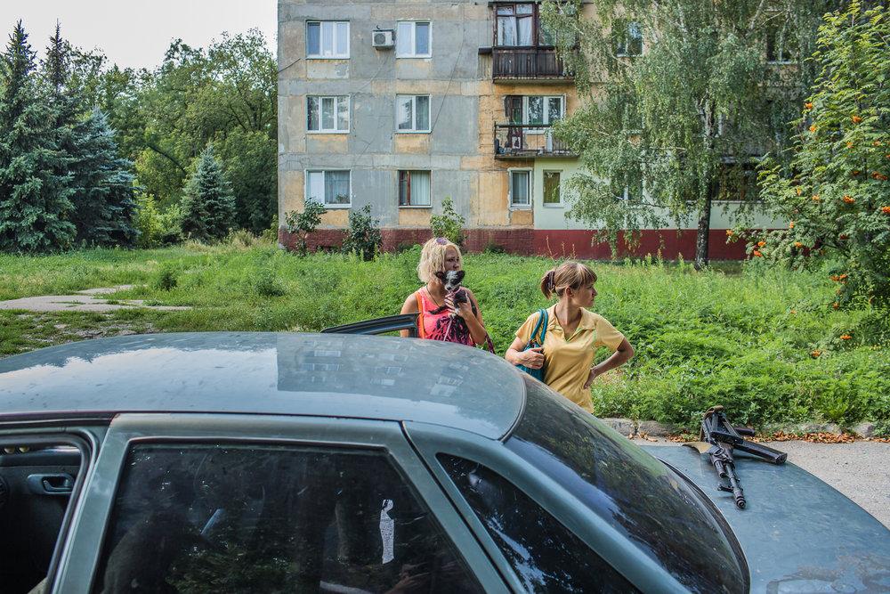 Residents of a front-line neighborhood. Donetsk, Ukraine. July 2014.