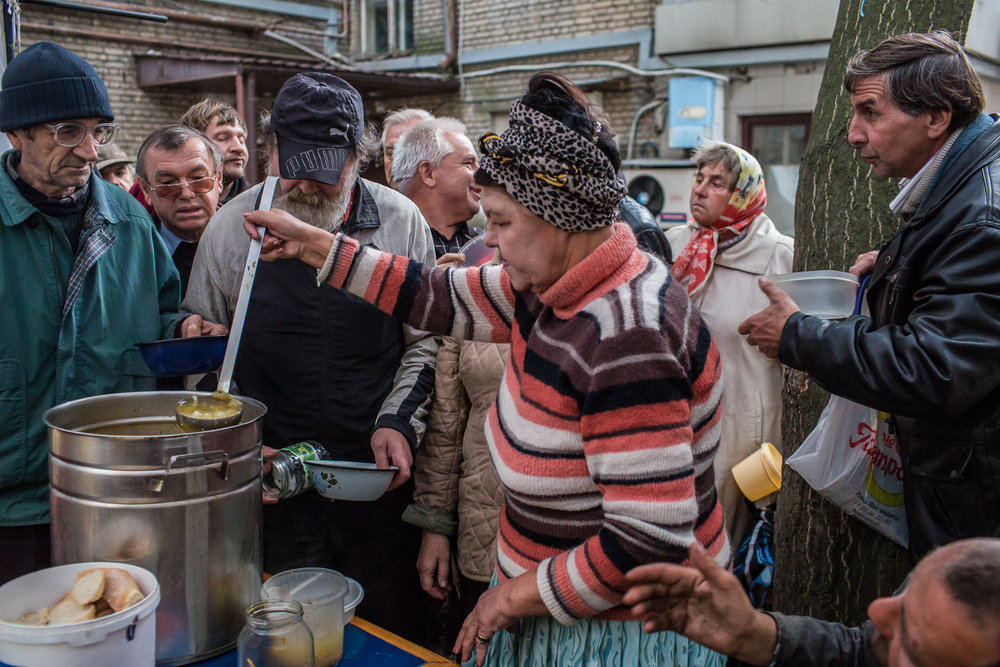 Free soup is served to those in need. Donetsk, Ukraine. October 2014.