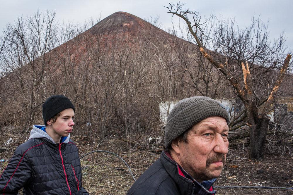 Aleksandr Zaytsev, right, whose wife and son were killed by shelling over the summer. Donetsk, Ukraine. February 2015.