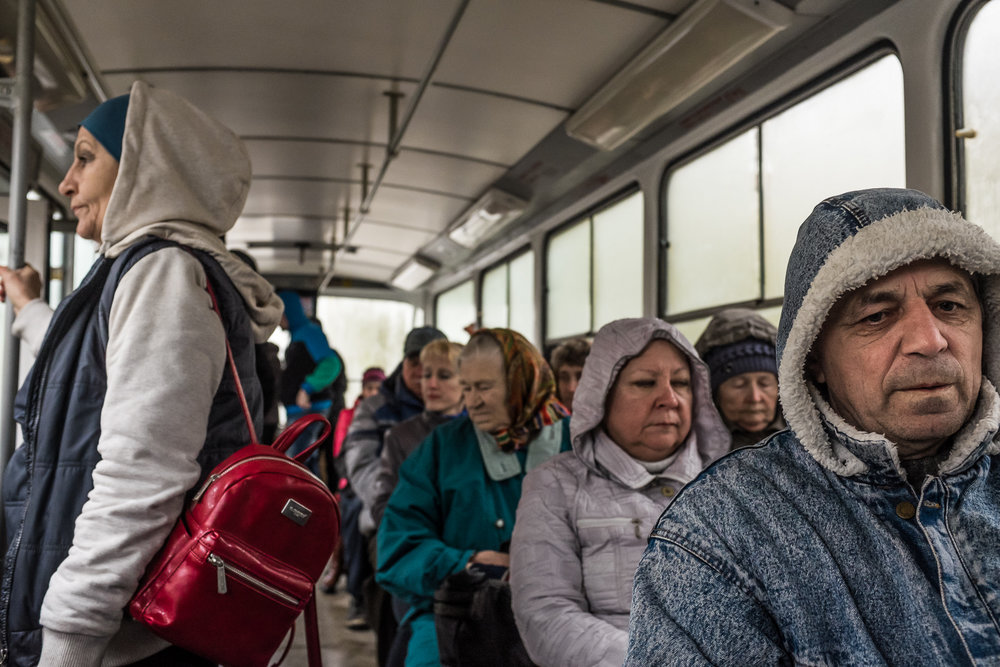 Passengers on a tram. Donetsk, Ukraine. April 2017.