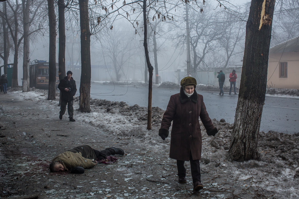Civilian casualty from shelling. Donetsk, Ukraine. January 2015.