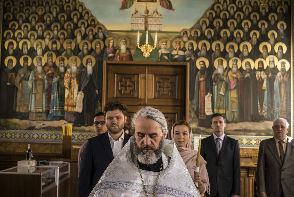 Father Philip conducts the wedding of Yevgeny Bolonnikov, second from left, and Katerina, third from right, at Life Spring Church at the Kyiv-Pechersk Lavra on Sunday, October 7, 2018 in Kyiv, Ukraine.