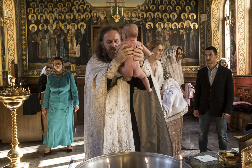 Father Ilya prepares to baptize Alisa, age three months, at the Life Spring Church at the Kyiv-Pechersk Lavra on Saturday, October 6, 2018 in Kyiv, Ukraine.