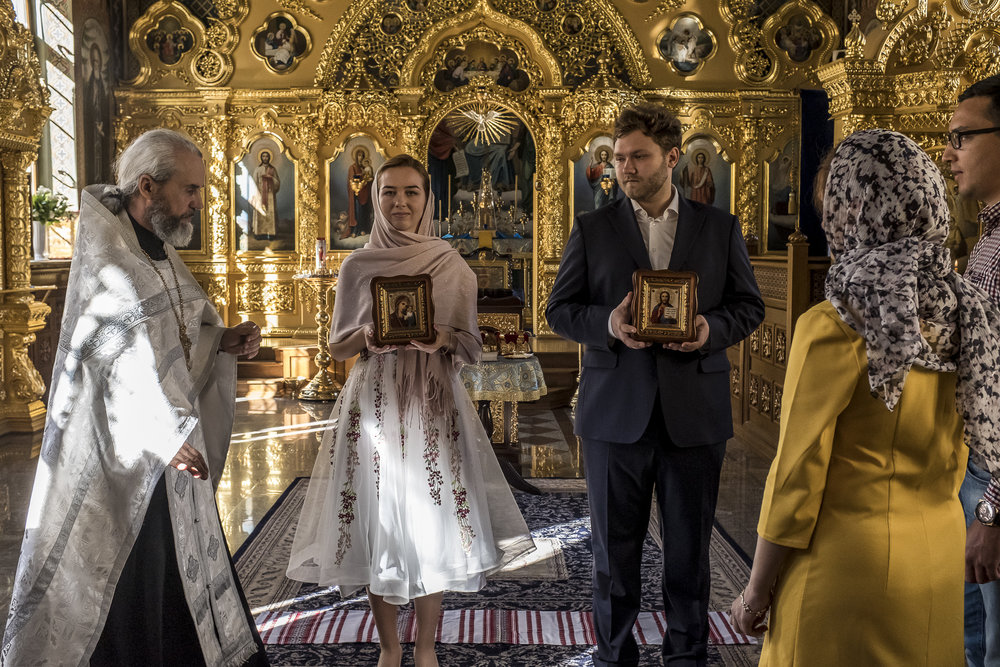 Father Philip, left, leads Katerina, second from left, and Yevgeny Bolonnikov, third from left, during their wedding at Life Spring Church at the Kyiv-Pechersk Lavra on Sunday, October 7, 2018 in Kyiv, Ukraine.