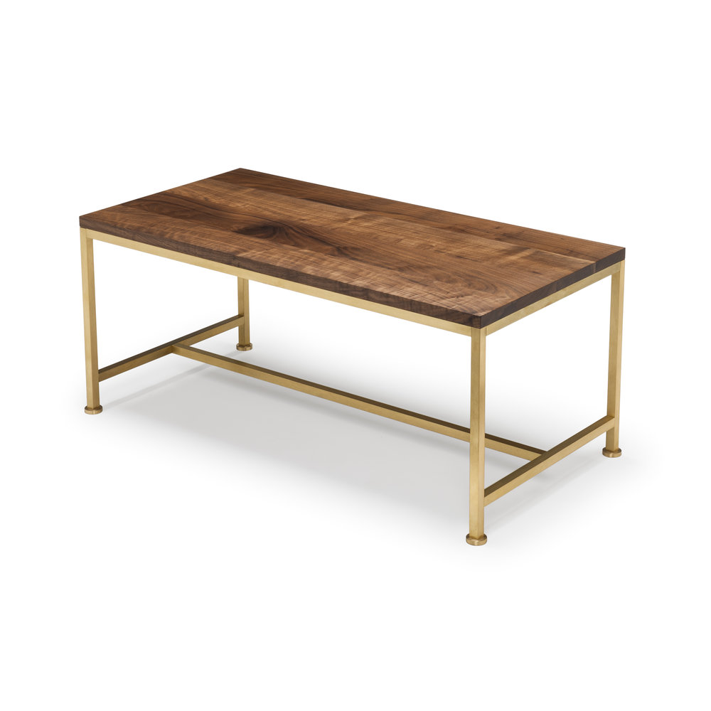 Orichal Coffee Table - The Orichal range is perfectionist and elegant in its simplicity featuring a precision engineered solid brass frame with a top in natural oiled walnut. We finish our brass frames with jade oil or renaissance wax, and so the finish will gently patina over time.♦ Height: 42cm | Width: 100cm | Depth: 50cm♦ Hand Signed No. 497Trade Price: £1,000 + vatQty: 1