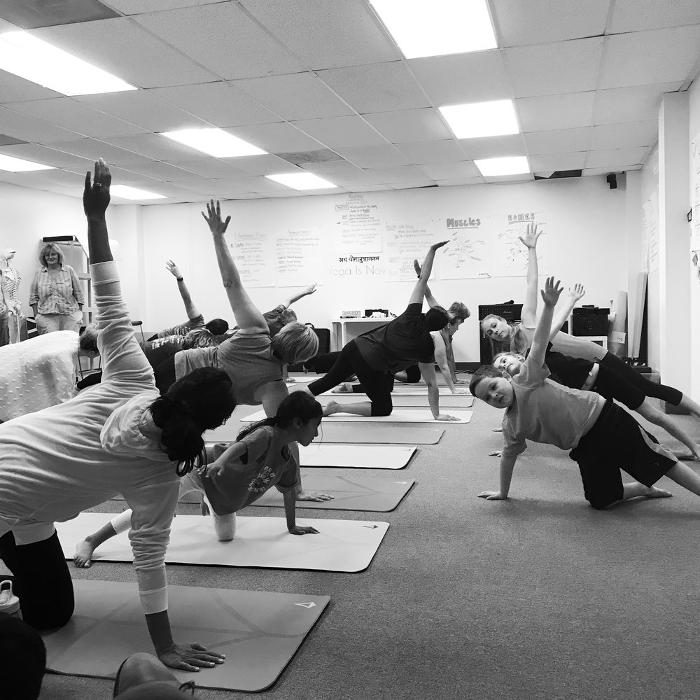 Berthold students in Lower Elementary lead a yoga class for their parents.