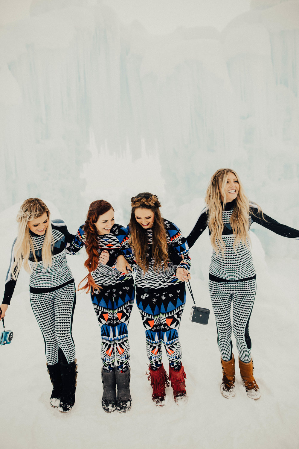 Instax Ice Queens, rocking their Sweaty Betty ski suits and Koolaburra snow boots at the ice Castles.