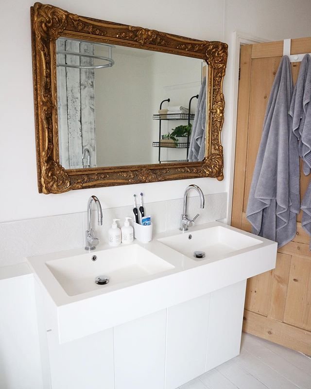 Hello dream double sink set-up! 🤤  The bathroom pretty much sealed the deal when we were viewing the house. It's a little rough round the edges in places and a few finishing touches are still needed. I have a pot of @farrowandball #Downpipe waiting to go on this wall to help the gold mirror pop ✨. It feels a bit stark and clinical in here at the moment - just need to convince the boyfriend 👀. For a girl who has always been loyal to white and bright this house has me craving colour! Please help us settle the debate 🙏🏼 ——————
