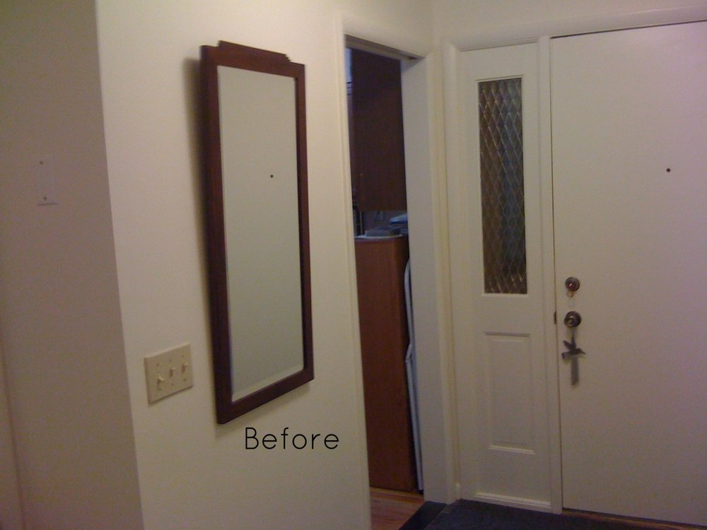 BEFORE: A plain mirror in the entryway.