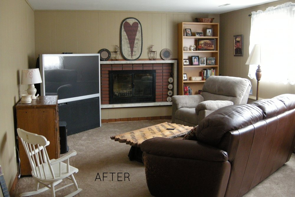 AFTER: The room is now a true family room with a new coffee table that I made from their family restaurant sign.