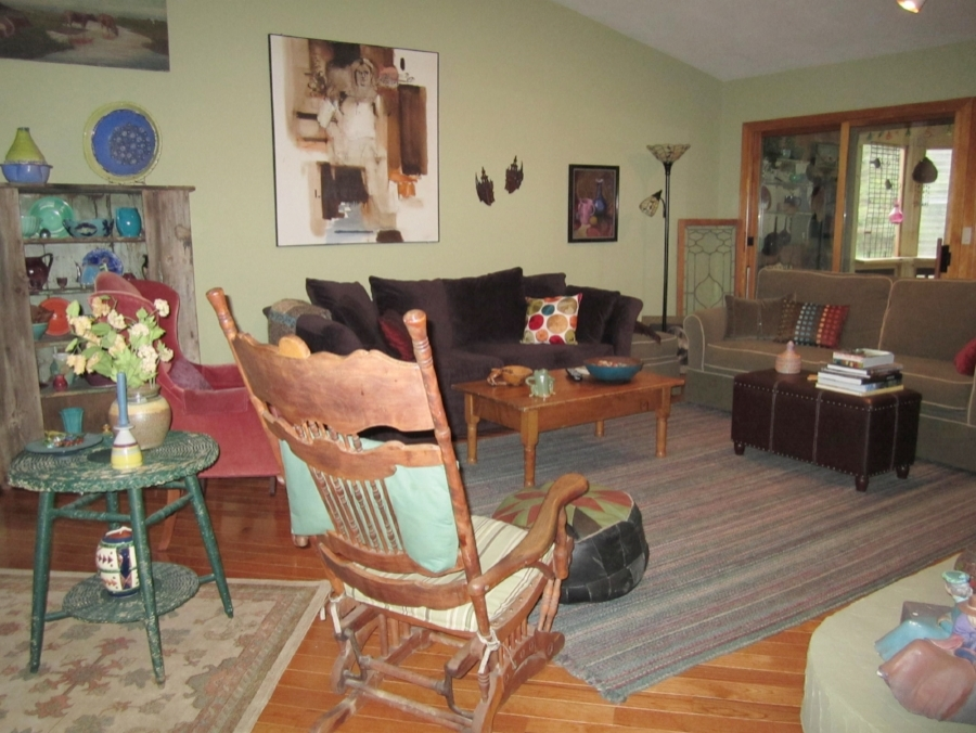 BEFORE: This seating area worked for everyday living, but required calming down for potential buyers.